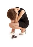 Crying girl with a gun. Picture of crying girl with a gun over white Royalty Free Stock Image