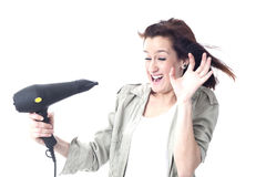 Crying girl holding hair dryer Stock Photography