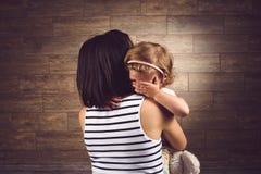 Crying Girl Hugging Mother Stock Photos
