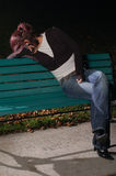 Crying girl on a park bench. This park is located in Longueuil, Canada. Lens: Nikkor 50mm, 2 external flashes with umbrella Stock Photos