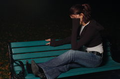 Crying girl on a park bench 4 Stock Image
