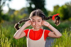 Crying girl with pigtails Royalty Free Stock Image