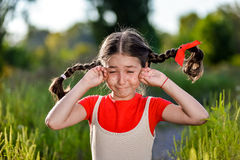 Crying girl with pigtails Stock Photography