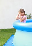 Crying girl in pool Stock Photo