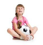 Crying girl with soccer ball  Stock Images
