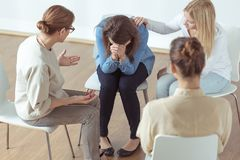 Crying during group therapy. Young despair women crying during group therapy Stock Photography