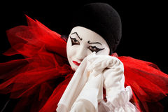 Crying with a handkerchief. Depressed Pierrot crying in a white handkerchief Royalty Free Stock Photo