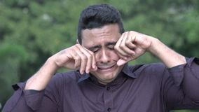 Crying Handsome Hispanic Man. A handsome adult hispanic man stock footage