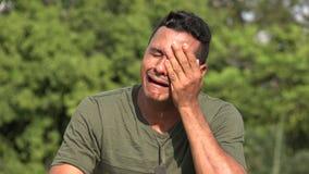 Crying hispanic male veteran