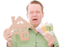 Crying houseowner with money Royalty Free Stock Photo