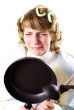Crying housewife with pan Stock Photo