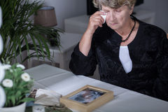 Crying after husband. Old women crying after death of her love Stock Photography
