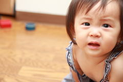 Crying Japanese baby girl. (0 year old royalty free stock photos
