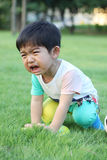 A crying kid. At park with her flying saucer Royalty Free Stock Photos