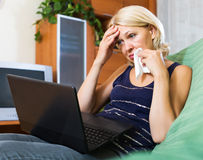 Crying lady receiving bad news Stock Images