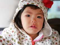 Crying little Asian baby girl, 22 months old, with tears royalty free stock image