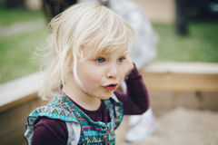 Crying little blond girl. Little blond girl with tears on her cheeks Stock Images