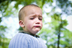 Sad little boy. A portrait of a sad little boy crying Stock Photo