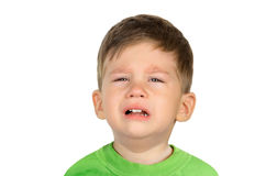 Crying little boy. Closeup portrait of a crying little boy isolated on white background Stock Photography