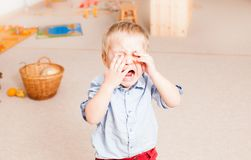 Crying little boy in the kindergarten Royalty Free Stock Photography