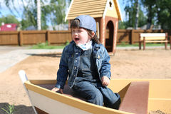 Crying little boy on playpit Royalty Free Stock Image