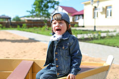 Crying little boy on playpit in summer Royalty Free Stock Photos
