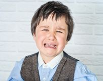 Crying little boy Stock Images