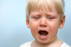 Crying little child. Portrait of crying little child stock image