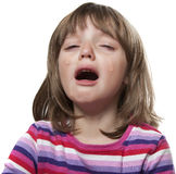 Crying little girl. White background Royalty Free Stock Image