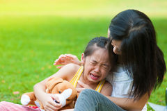 Crying little girl. Mother is comforting her crying daughter Royalty Free Stock Photos