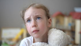 Crying little girl. Crying little girl with bear in the children's room stock video