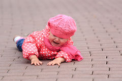 Crying little girl fall off on sidewalk Royalty Free Stock Images