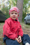 Crying little girl in forest Royalty Free Stock Photos