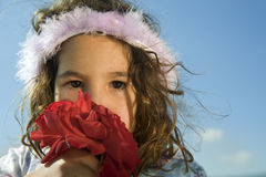 Crying Little Girl With Roses Stock Image