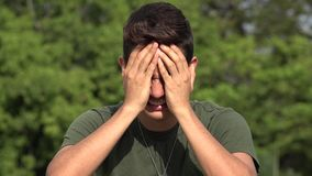 Crying Male Hispanic Teenage Soldier Recruit. A handsome hispanic male teen stock footage