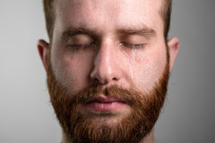 Crying Man with Beard. Close Up of a Crying Man with Red Beard Stock Photos