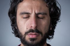Crying Man with Beard. Man with Beard and Long Hair Crying with Closed Eyes stock photo
