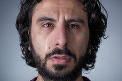 Crying Man with Beard. Man with Beard and Long Hair Crying Looking at Camera royalty free stock images