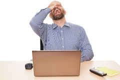 Crying man. A crying man in front of his PC isolated on white background Royalty Free Stock Image