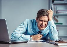 Photo of office man with Negative facial expression at the working place. Crying man. Photo of office man with Negative facial expression at the working place royalty free stock photo