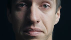 Close up portrait of crying man with tears. Crying man with tears in eye closeup stock footage