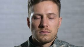Crying military veteran looking in camera close-up, psychotherapy, depression. Stock footage stock video footage