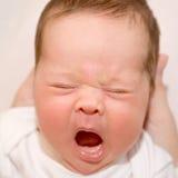 Crying newborn. Close-up portrait of crying newborn. Something bothers him stock photos