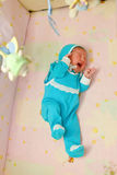 Crying newborn baby. In the crib. He is lonely. Something bothers him stock images