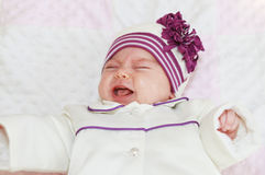 Crying newborn baby girl Stock Photos