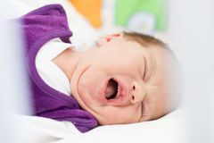 Crying newborn baby girl Stock Photography