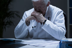 Crying old doctor Stock Photo