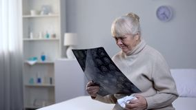 Free Crying Old Lady Looking At Brain X-ray In Hospital, Incurable Disease, Health Stock Image - 148647861