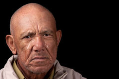 Crying old man. An old man cries whilst staring aimlessly Royalty Free Stock Photo