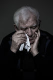 Crying old man. Photo of older, depressed lonely man crying royalty free stock photo